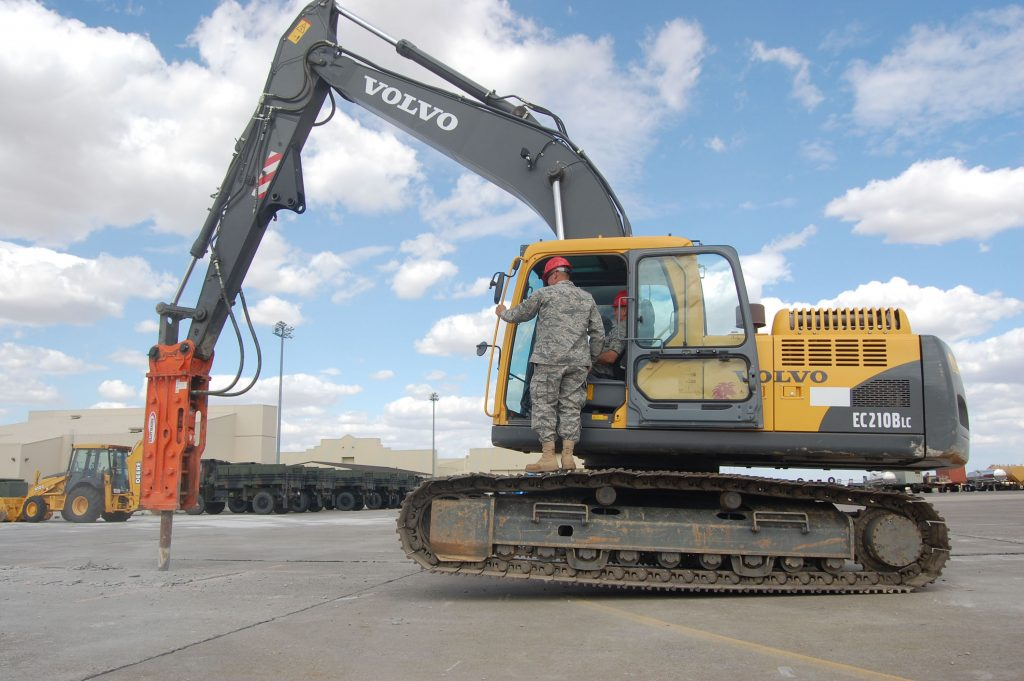 Maj. Gen. Floyd Carpenter, 8th Air Force vice commander, learns how to pulverize and tear up concrete in an excavator from Airman 1st Class Brandon Lynch, 819th RED HORSE Squadron, during a ground breaking ceremony at Malmstrom Air Force Base, Mont., Aug. 14. The 819th RHS is tearing up a 20,000 square foot area to build a unit assembly area; a $678,000 construction project slated to be completed by March 2009 and built entirely by the squadron. Lt. Gen. Robert Elder, 8th AF commander, and General Carpenter, both participated in the ground breaking ceremony. (U.S. Air Force photo/Senior Airman Eydie Sakura).